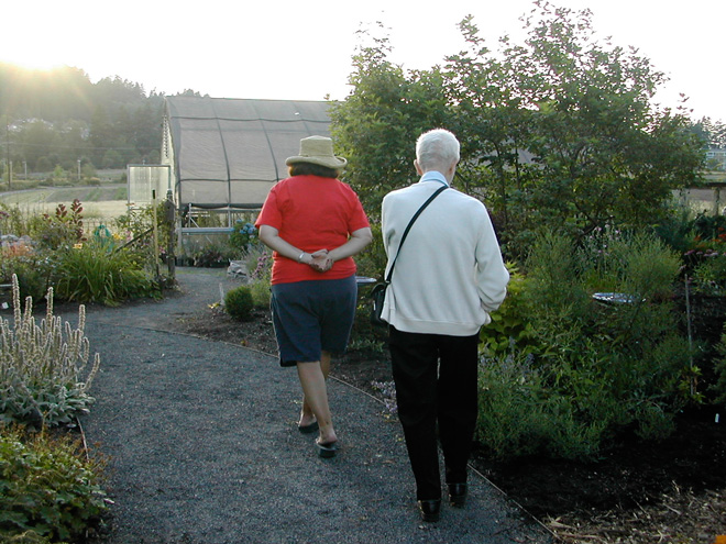 Brewster Rogerson and Linda Beutler strolling in the Rogerson Clematis Collection. Photo: Larry Beutler