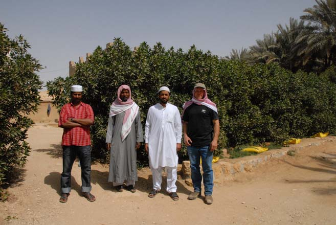 Workers from Pakistan and Bangladesh with Ben on the right.  Photo: Kate Frey