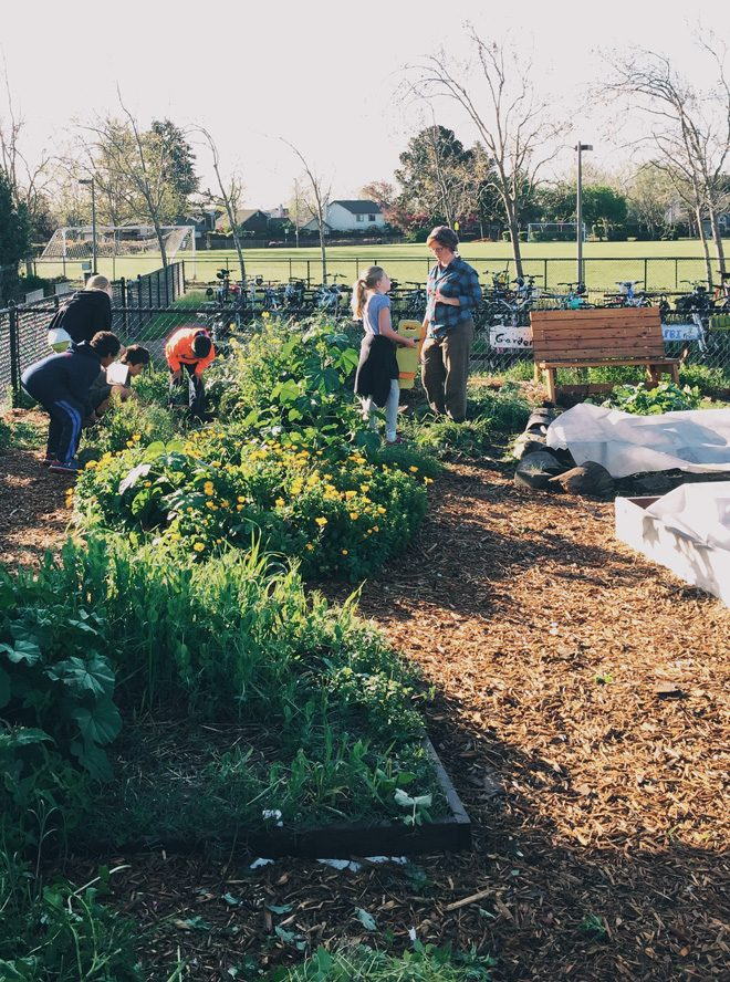 Older students work together on garden tasks... Photo: Ethan Bodnar