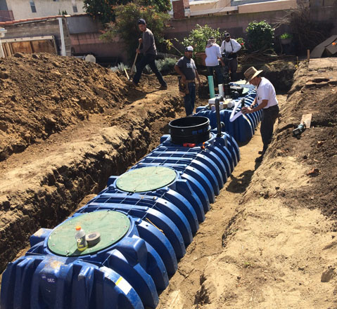 Two underground tanks buried in the backyard on the same property have a 3,574-gallon holding capacity. Photo: Urban Water Group