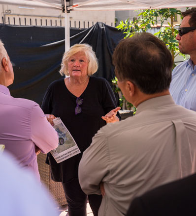Author Marilee Kuhlmann of Urban Water Group (pictured above in black) walks directors from city agencies that funded the project through a recently installed case study site. Photos: courtesy of The Greater LA Water Collaborative