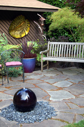 The garden is furnished with artwork and accessories that complement the plantings. Photo: Deb Caulderon