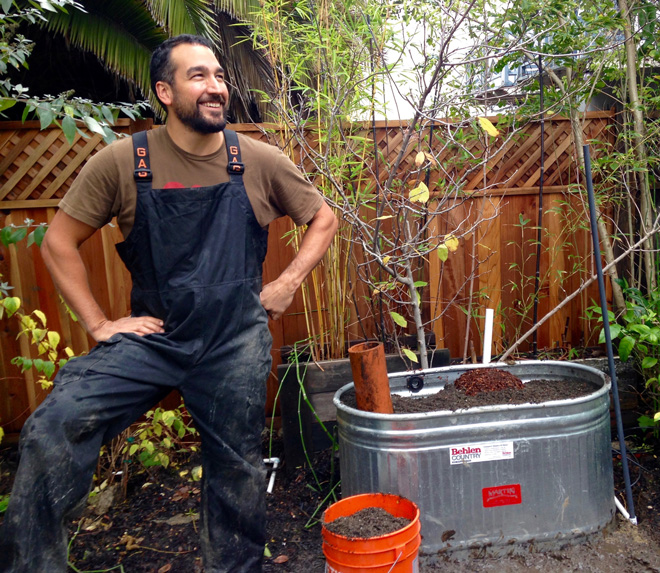 Crew leader Anthony Gutierrez builds a Living Fountain—a Mariposa creation that cleans laundry water by biofiltration.  Photo: Andrea Hurd
