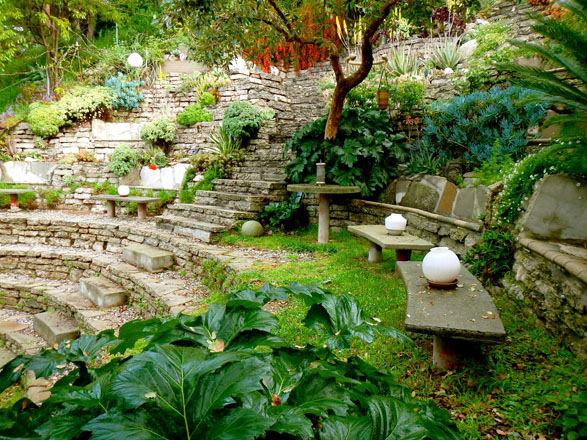 Seating terraces sculpted into the garden's amphitheater accommodate friends and neighbors for performances. Photo: James Griffith