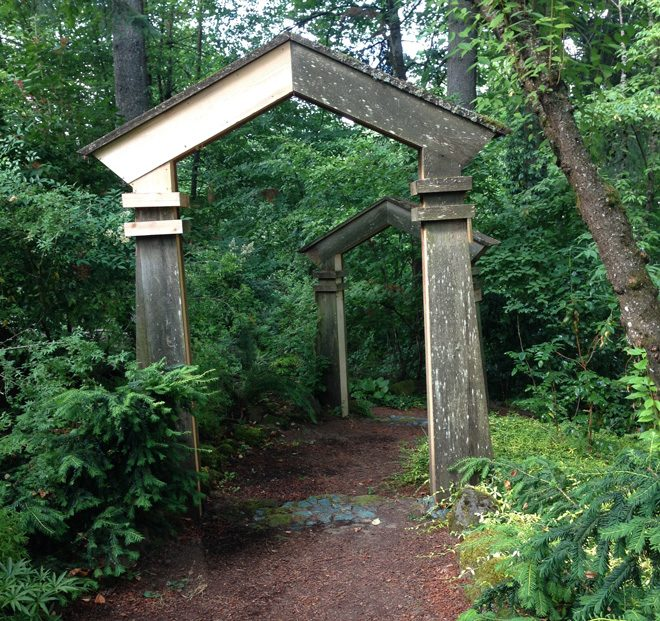 Architectural portals lure visitors into the Bella Madrona woodland garden. Photo: Lorene Edwards Forkner