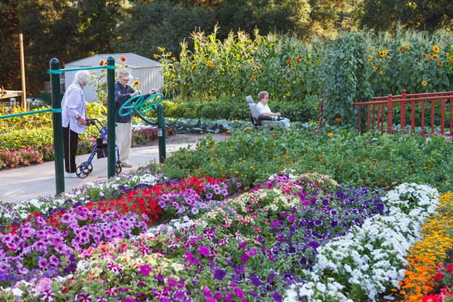 Generous pathways allow residents to stroll or navigate their wheelchair amongst the colorful plantings. Photo: Saxon Holt