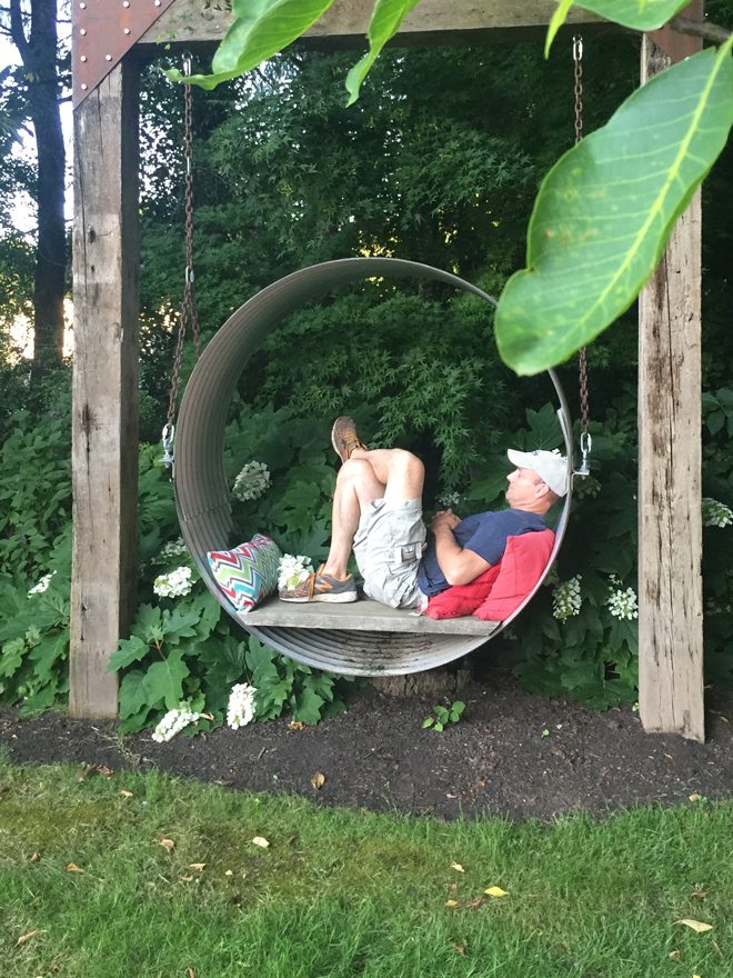 A novel swing in the back yard is a space for quietude, rest, and relaxation. Photo: P. Annie Kirk