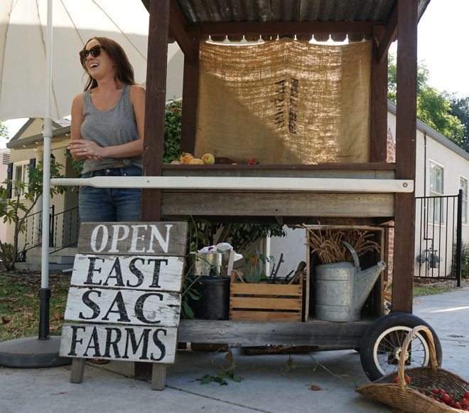 "Morgan Daily (pictured here) and Kyle Hagerty run ""East Sac Farms,"" their bi-monthly front yard farm stand, and encourage their neighbors and friends to contribute as well. Photo: Melissa Keyser"