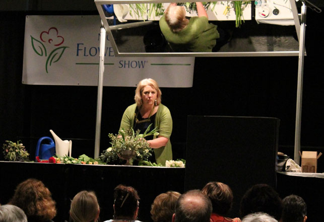 Speakers like Martha Stewart and actress Sally Field, and horticulture royalty like Rosemary Verey, Piet Oudolf, Fergus Garrett, Beth Chatto, Dan Hinkley, and James Van Sweden have graced the stage as a part of the show's seminar series. Pictured here: Debra Prinzing, Slow Flowers advocate, on the DIY stage. Photo: courtesy of NWF&G Show