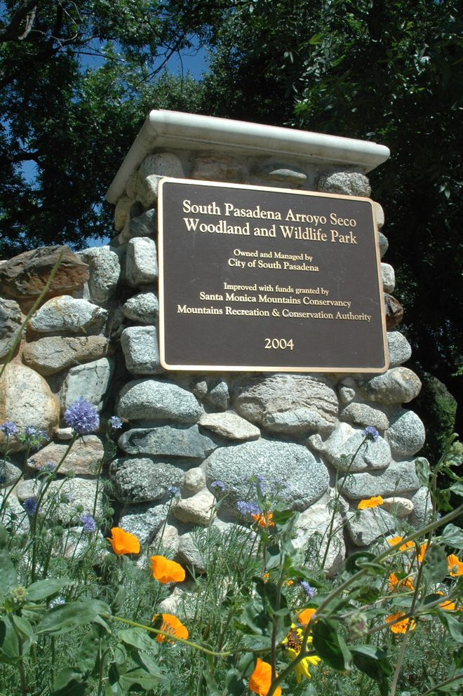 Spring blooming California native wildflowers at the entrance to Arroyo Seco Woodland and Wildlife Park crafted from local river rock.   Photo: Barbara Eisenstein
